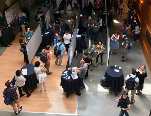 Presenters and attendees mingle at the GCCBOSC 2018 poster/demo session